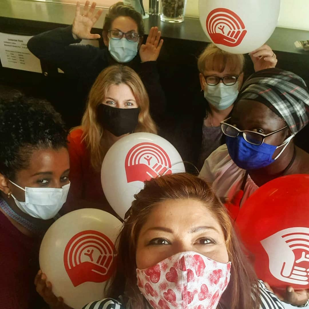 Immigrant Centre staff with United Way Winnipeg Campaign balloons